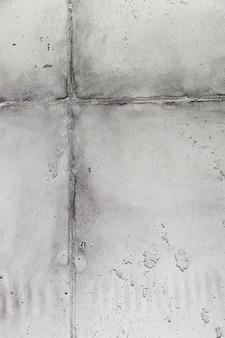 Cementwandoppervlak met voeg