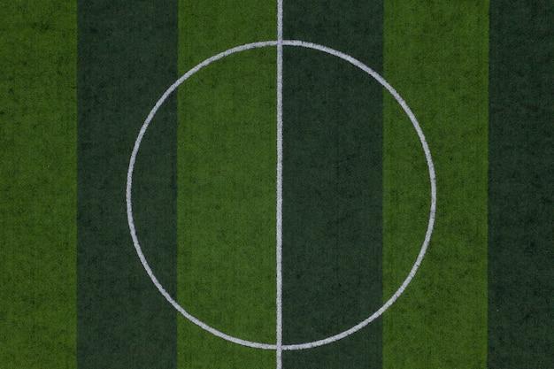 Centrum van voetbalveld, gestreepte voetbalveld achtergrond, groen gras voetbalveld achtergrond