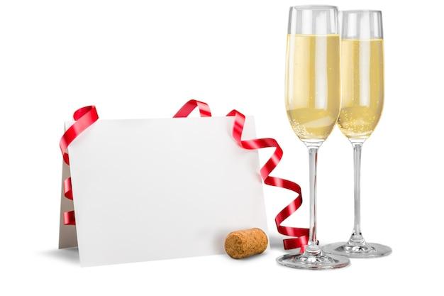 Champagnefluiten met wimpel en blanco kaart
