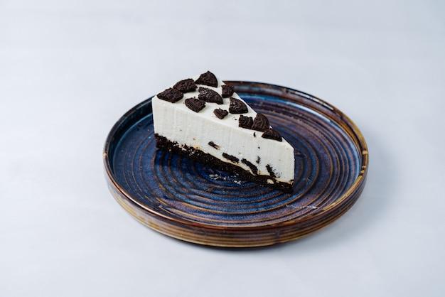 Cheesecake gegarneerd met oreokoekjes