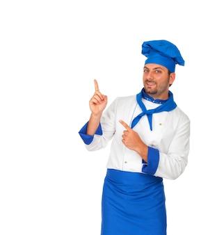 Chef-kok die naar boven wijst