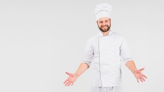 Chef-kok die schouders ophaalt