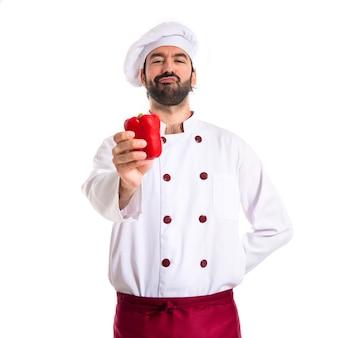 Chef-kok met rode peper