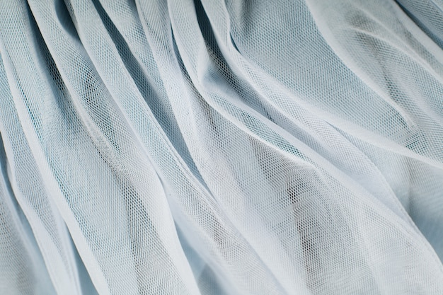 Chiffon tule stof gestructureerde achtergrond. geplooide rok stof textuur. close-up plissé stof structuurpatroon