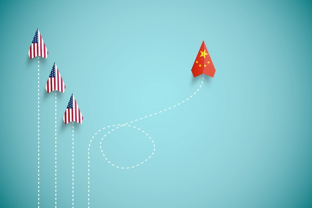 China vlag print scherm op papieren vliegtuig vliegt en niet in lijn met het vliegtuig van de vs. china land is concurrent van de verenigde staten van amerika en belemmert een handelsoorlogcrisis.