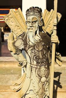 Chinees standbeeld bij de tempel van watpho, bangkok, thailand