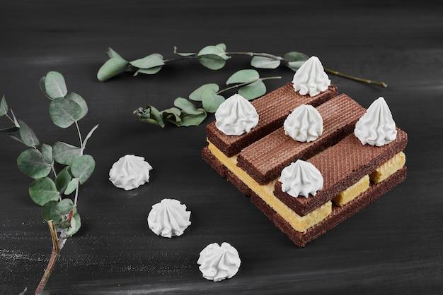 Chocoladewafels met witte room.