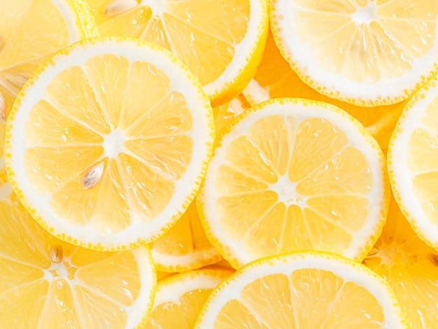 Citrus, gezonde voedingsvitamine. citroen plakjes achtergrond.