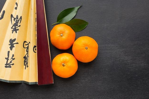 Citrusvrucht voor chinees nieuwjaar en ventilator