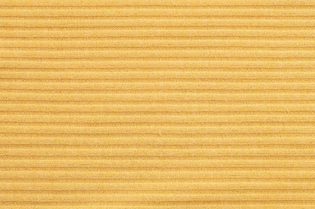 Close-up abstract patroon bij de geweven achtergrond van gele vrouwenkleding