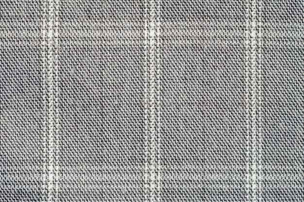 Close-up abstract patroon bij de geweven achtergrond van grijze vrouwen laag