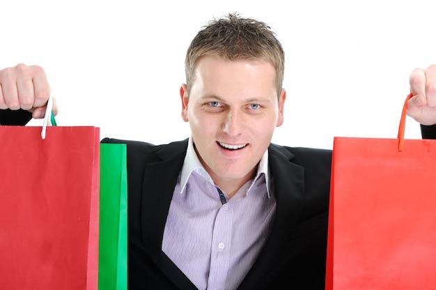 Close-up foto van een zakenman met boodschappentassen
