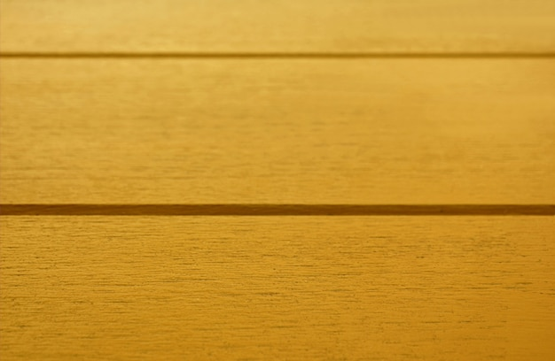 Close-up geel gekleurde houten tafel oppervlak