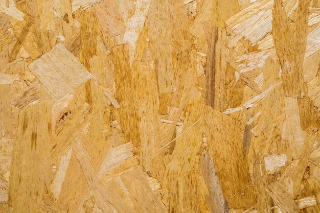 Close-up geperste houten paneel achtergrond, naadloze textuur van georiënteerde strand board - osb hout.