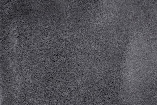 Close-up getextureerde grijze lederen achtergrond, kleine korrel en rimpelig
