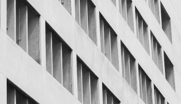 Close-up geventileerde gevel van betonnen gebouw. wit gebouw. architectuur abstracte achtergrond.