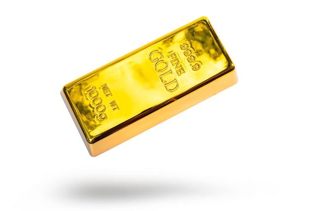 Close-up glanzend een goudstaaf 1 kg op witte achtergrond met uitknippad