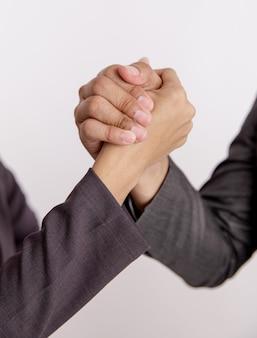 Close-up hand bedrijf eenheid geïsoleerd witte achtergrond te houden