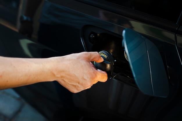 Close-up hand opening autotank