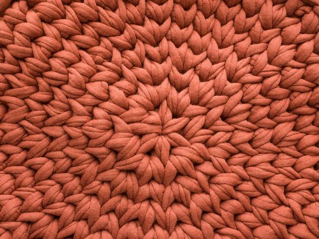 Close-up katoen bruin gebreide deken, warme en comfortabele sfeer.