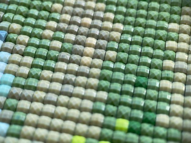 Close-up, kleurrijk vierkant diamantborduurwerk helder. hobby's en amusement.