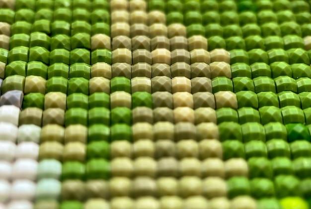 Close-up, kleurrijke textuur vierkante diamant borduurwerk helder. hobby's en amusement. doe-het-zelf-concept.