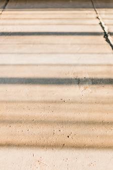 Close-up lage hoekopname van een betonnen stenen muur voor achtergrond of behang