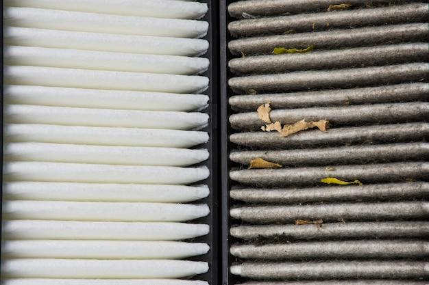 Close-up macro van nieuwe en oude auto luchtfilter oppervlakken