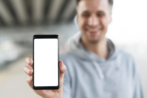 Close-up man met mobiele telefoon