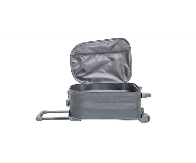 Close-up open zwarte die bagage op wit wordt geïsoleerd