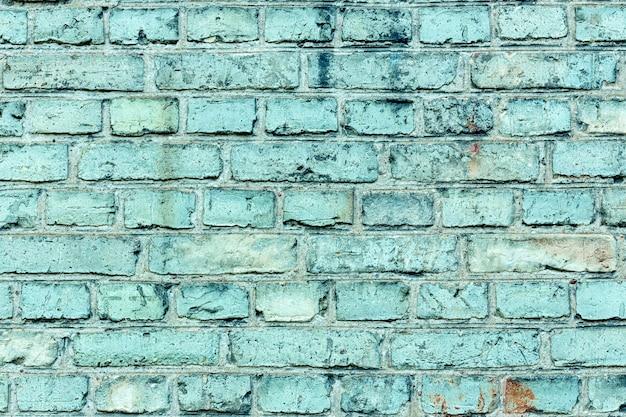 Close-up oude azuurblauwe bakstenen muur