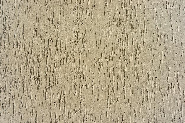 Close-up shot van een beige getextureerde muur