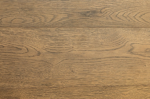Close-up van bas-hout laminaat vloerbedekking van grijsbruine kleur