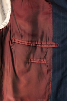 Close-up van binnenzak van mannelijke jas