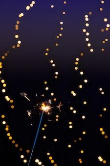 Close up van brandend sterretje met bokeh lichten