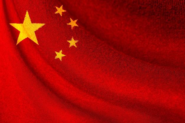 Close-up van china vlag zwaaien voor achtergrond en textuur. republiek china land is een lange culturele geschiedenis en snelgroeiende economische technologie.