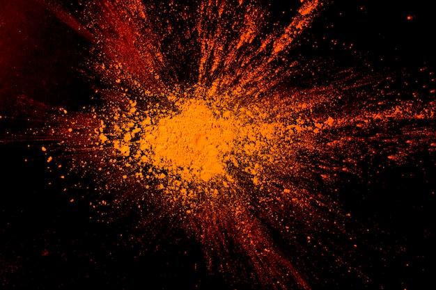 Close-up van de abstracte oranje achtergrond van de poederverf