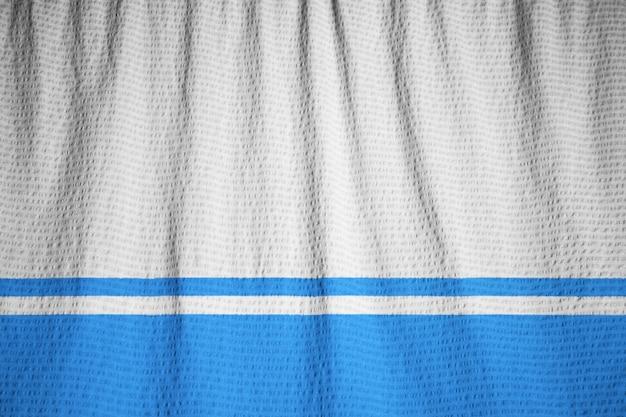 Close-up van de gegolfde altai republiek vlag, altai republiek vlag waait in de wind