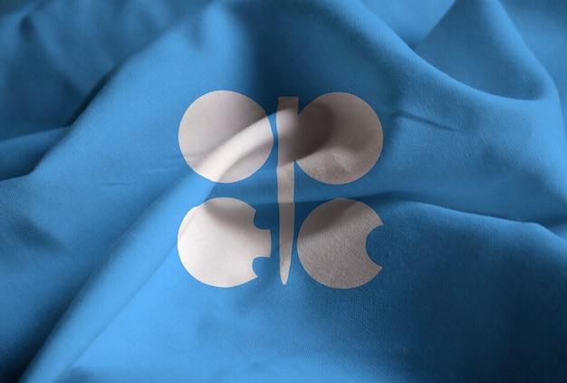 Close-up van de gegolfde organisatie van de vlag van de olie-exporterende landen