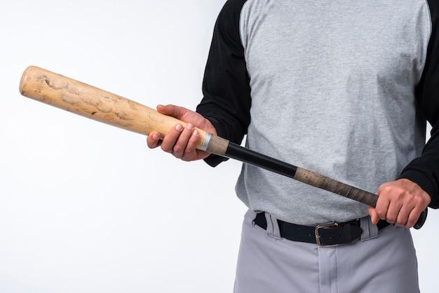 Close-up van de holdingsknuppel van de honkbalspeler