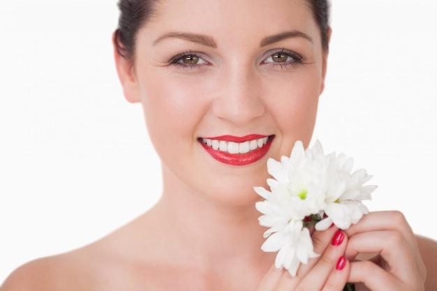 Close-up van de jonge bloem van de vrouwenholding