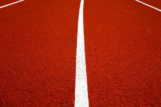 Close-up van de rode stadionrenbaan