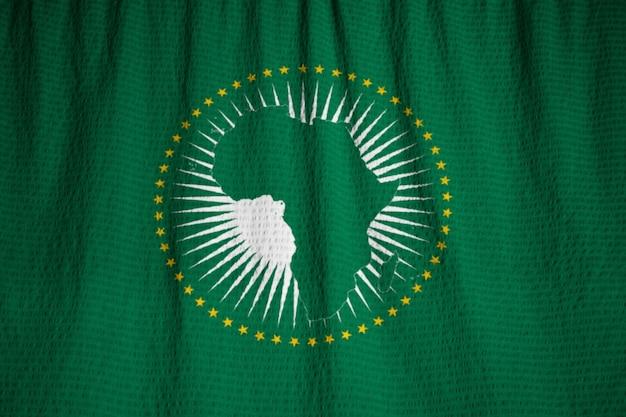 Close-up van de ruches afrikaanse unie vlag, afrikaanse unie vlag waait in de wind