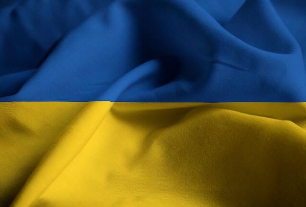 Close-up van de ruffled vlag van de oekraïne, de oekraïne vlag die in wind blazen