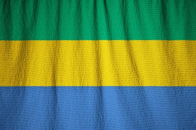 Close-up van de ruffled vlag van gabon, de vlag die van gabon in wind blaast