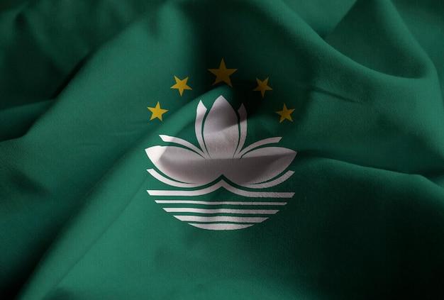 Close-up van de verstoorde vlag van macau, macau vlag waait in de wind