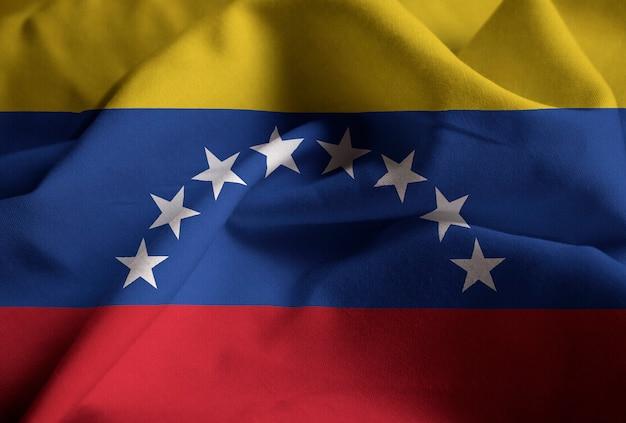 Close-up van de verstoorde vlag van venezuela, vlag van venezuela waait in de wind