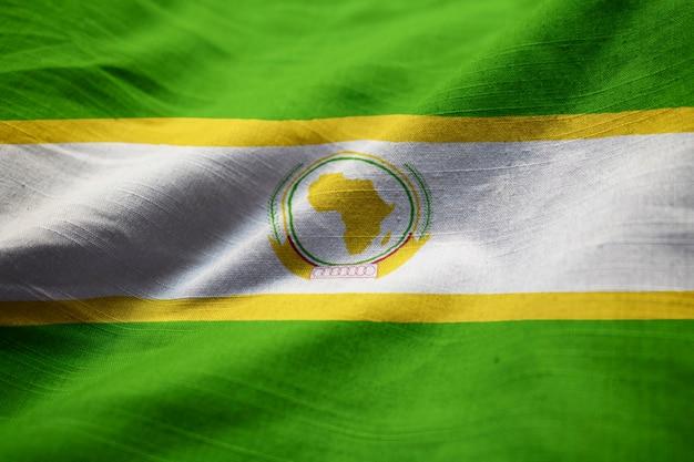 Close-up van de vlag van de afrikaanse unie, de afrikaanse unie vlag waait in de wind
