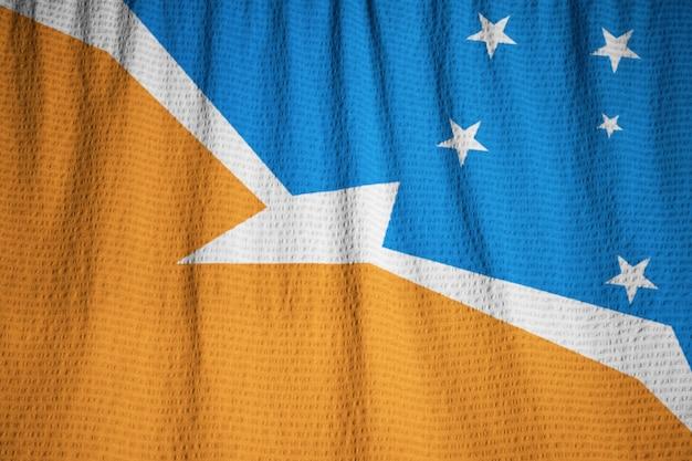 Close-up van de vlag van ruffled terra del fuego, vlag van terra del fuego blazen in de wind