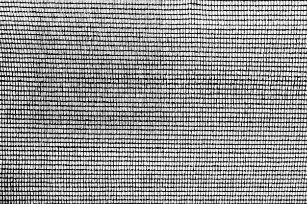 Close-up van de zwarte achtergrond van het strepen textielpatroon